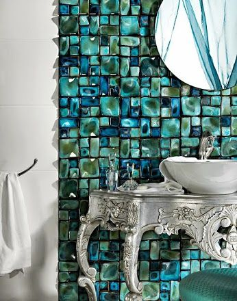 The aqua marine tile on the walls makes this a vanity that anyone would love!