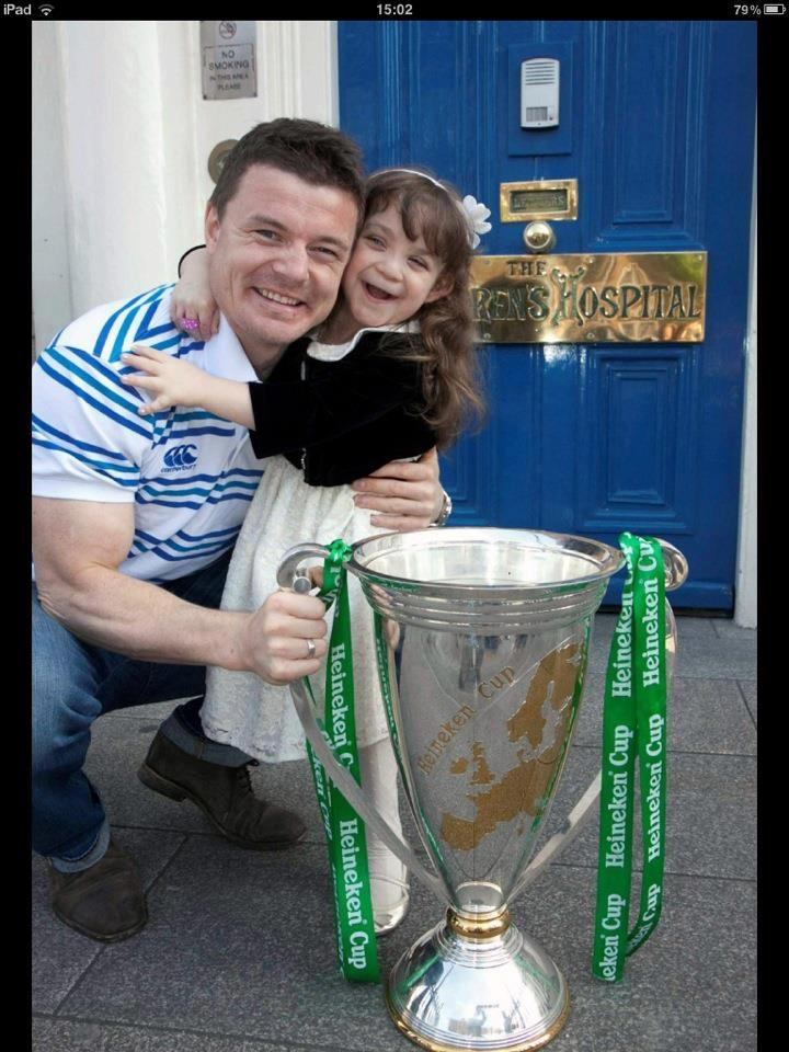 PART 2 to the BO'D pic...One year on and Irish rugby player Brian O'Driscoll makes return visit to see little girl with Heineken Cup. Her smile and happiness is so amazing!!!