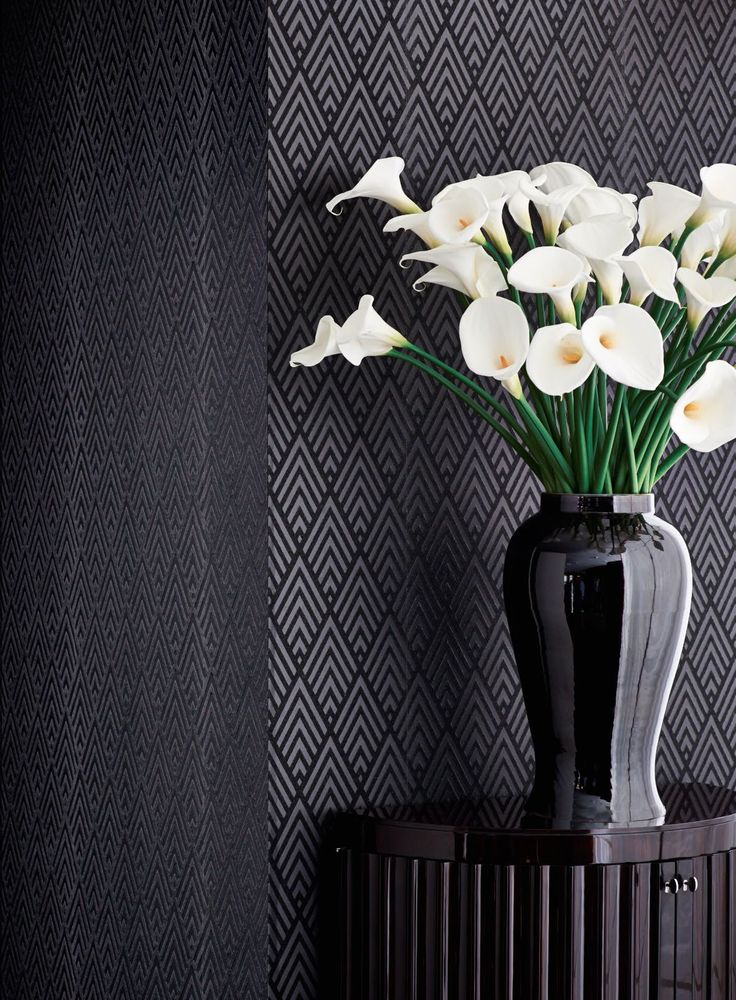 White calla lilies in stark contrast to Ralph Lauren Home's Jazz Age Geometric wallcovering in charcoal