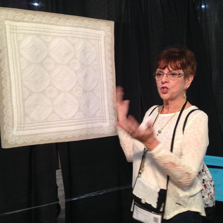 Monique Figlietti talking about her quilt during one of our exhibit tours.