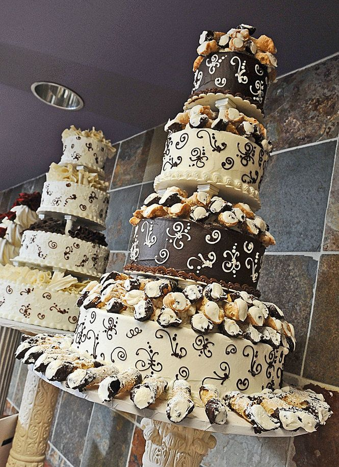 Step out of the box with a cannoli cake!!! :) ilike the idea of serving other desserts on wedding cakes