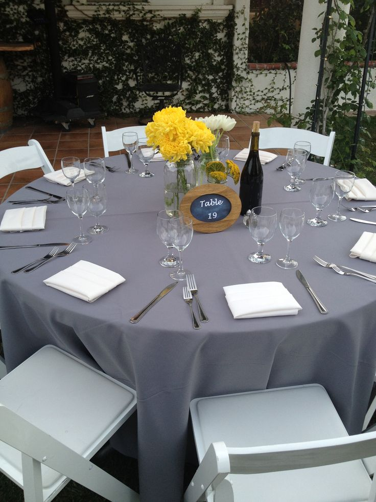 Wedding table Gray and yellow color scheme Yellow flowers gray table linen  I Caterer