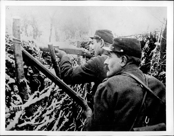 "WWI; ""French sharpshooters in action in a trench getting hit by heavy snowfall on the Western Front"" -Getty Images"