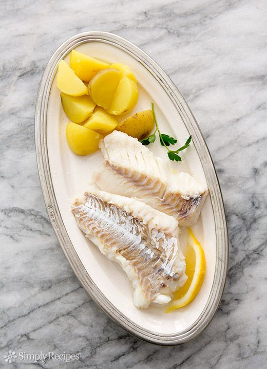 Cod poached in water infused with bay leaves, garlic, salt, and olive oil. ~ SimplyRecipes.com