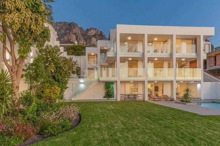 Geneva Drive 26 is a ultra-luxurious five bedroom 5 bathroom villa in Camps Bay with spectacular views across Lion's Head and Camps Bay. Camps Bay beach is a short stroll away. The villa features a heated swimming pool in a large garden, perfect for relaxing in the sun.