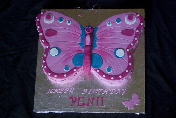 I want the cake to be in this shaped but purple. and if im not able to do it in this shape then I wanna make a butterfly made out of fondant and put it on the cake.