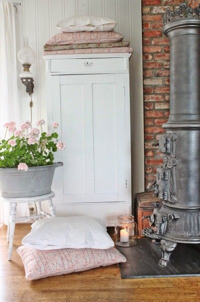 Love this exposed brick wall in this cottage tour...n I absolutely hafta have a heat stove like that into my dream home.. eclecticallyvintage.com