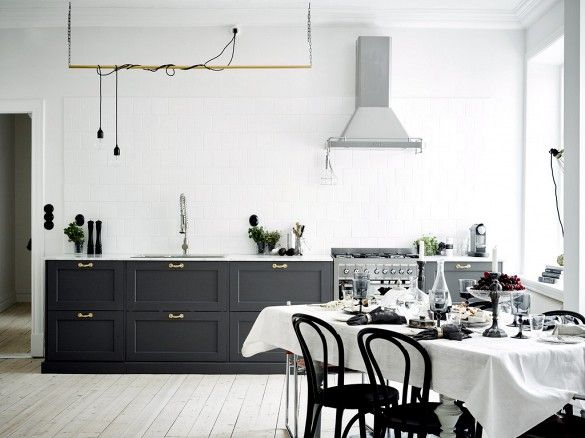 Kitchen with no upper cabinets and loose pendant lights