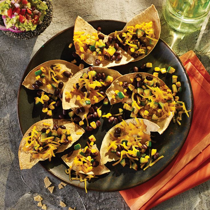 Crunch on these party-perfect appetizers. The #HEBRecipe for Black Bean Nachos makes a great finger food for game day! Ready in just 15 minutes.