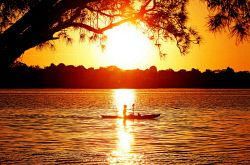 TWA-0006071 © WestPix The sun sets on the Canning River in Shelley as a kayaker enjoys the Friday afternoon setting.
