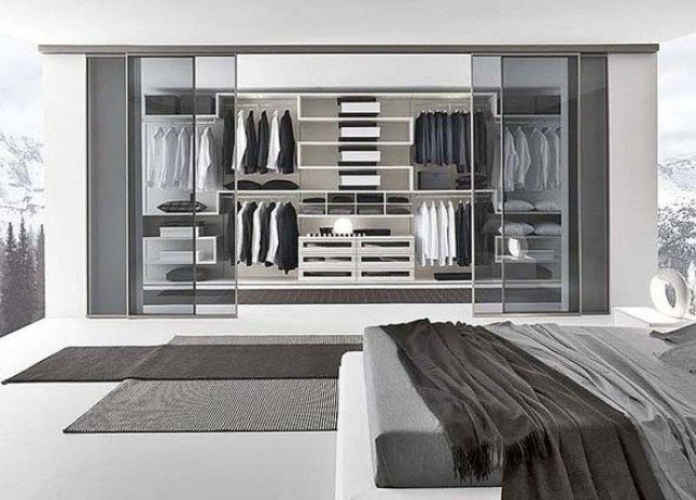 Walk in modern closet love the neutral black and white for Modern walk in closets