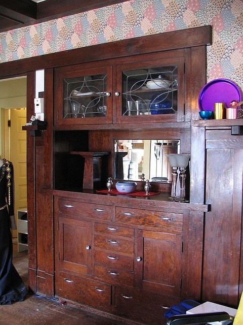 1911 Craftsman bungalow in Seattle, WA. Craftsman built-in sideboard. Ugly wallpaper and bad modern hardware, but the built-in is quite lovely with the leaded glass.
