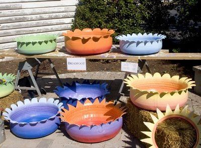 Turning Tires into Planters | Turn them inside out, cut a fancy edge and add a bright color.