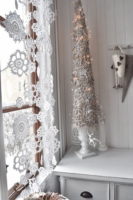 Christmas decorating idea - Small doily snowflakes hanging in window