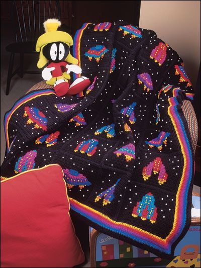 """Spaceship Afghan -Our colorful 48"""" x 58"""" child-pleasing afghan is made with worsted weight yarn.  Skill Level: Intermediate  Designed by Eleanor Albano-Miles  free pdf from freepatterns.com"""