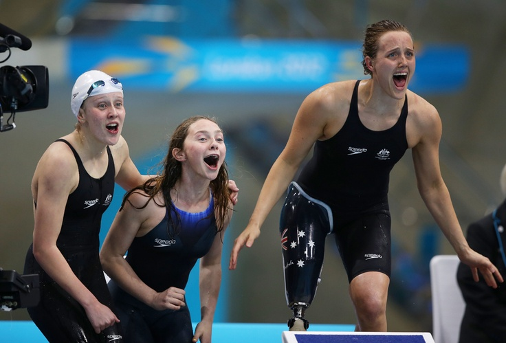 From left: Katherine Downie, Ellie Cole and Maddison Elliot of Australia celebrate as teammate Jacqueline Freney wins them the gold medal in the Women's 4x100m Freestyle 34 Points final on day 5 of the London 2012 Paralympic Games at the Aquatics Center on Sept. 3. (Clive Rose/Getty Images) #