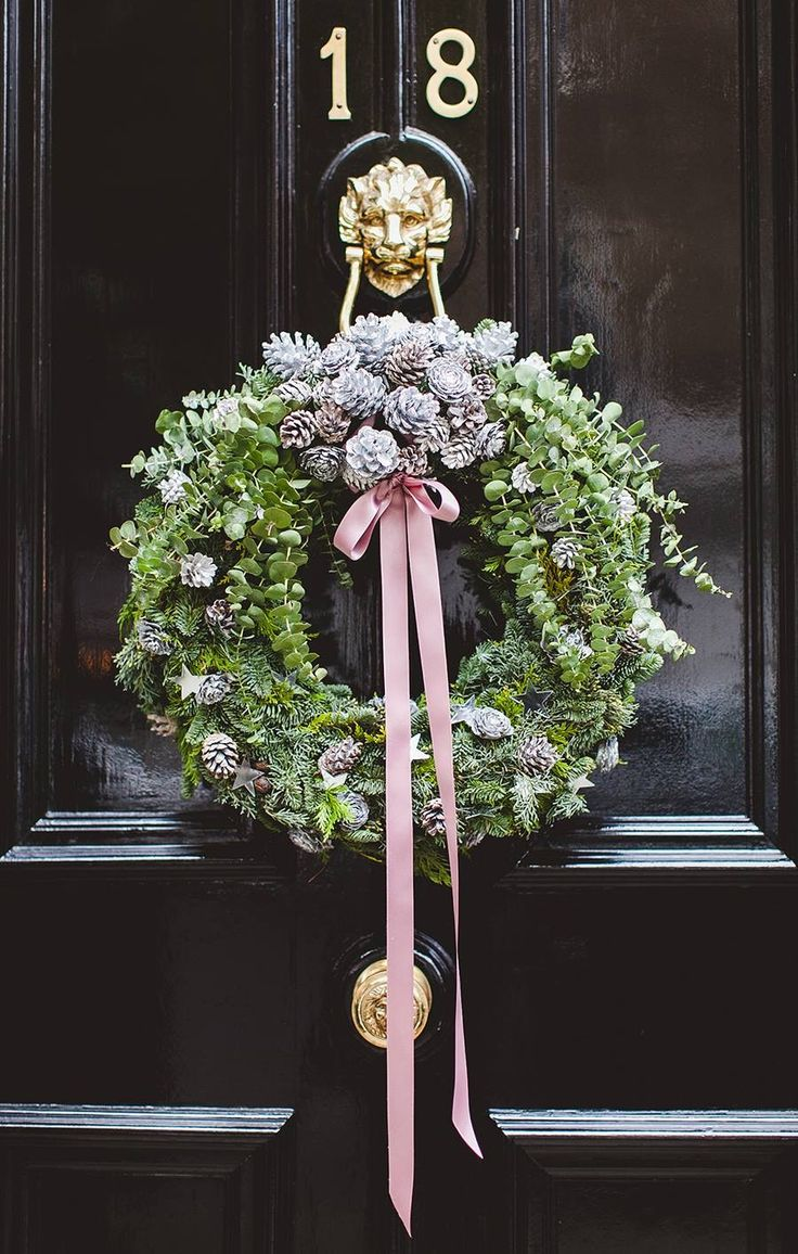 wreath / black door / brass door knocker