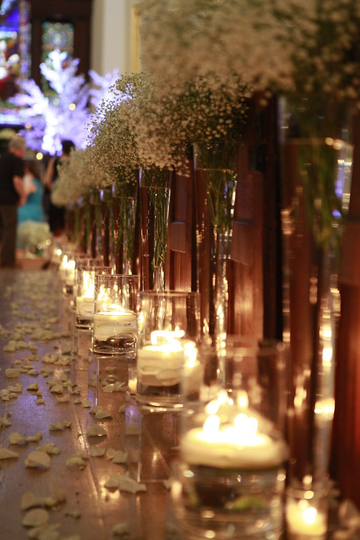 Church aisle framed with baby breath and small candles for a romantic look.  Ceremony  Photographer: Harley Hall Reinhardt