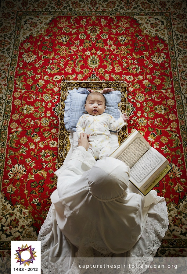 This is just adorable, put the baby to sleep with the recitation of Quran <3