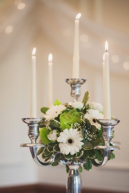 White/cream candelabra, table centre piece, with gerberas, ranunculas and gypsophilia. Wedding and Civil Partnership Flowers - Stems of Beauty - Florist - High Wycombe, Buckinghamshire