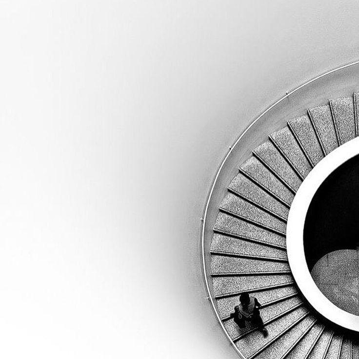 Its a swirl around the stairs. #minimalist #minimalism #minimalist #photography #blackandwhite #stairwell #structure #architecture in #blackandwhite #photography in phlow