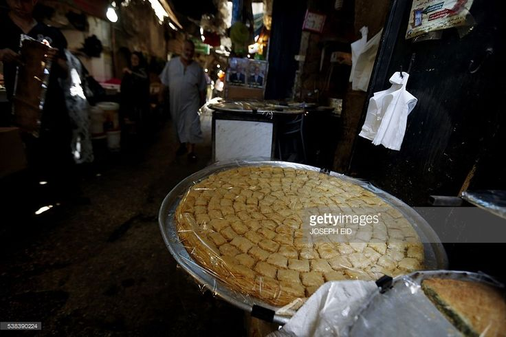 Lebanese Muslims shop prior to Iftar in the old market of Tripoli, north of Beirut, on June 6, 2016, on the first day of the holy month of Ramadan. Islamic authorities across much of the world -- from the most populous Muslim-majority country Indonesia to Saudi Arabia, home to the faith's holiest sites -- announced the start of the fasting month with the sighting of the crescent moon. Marking the divine revelation received by Isla...