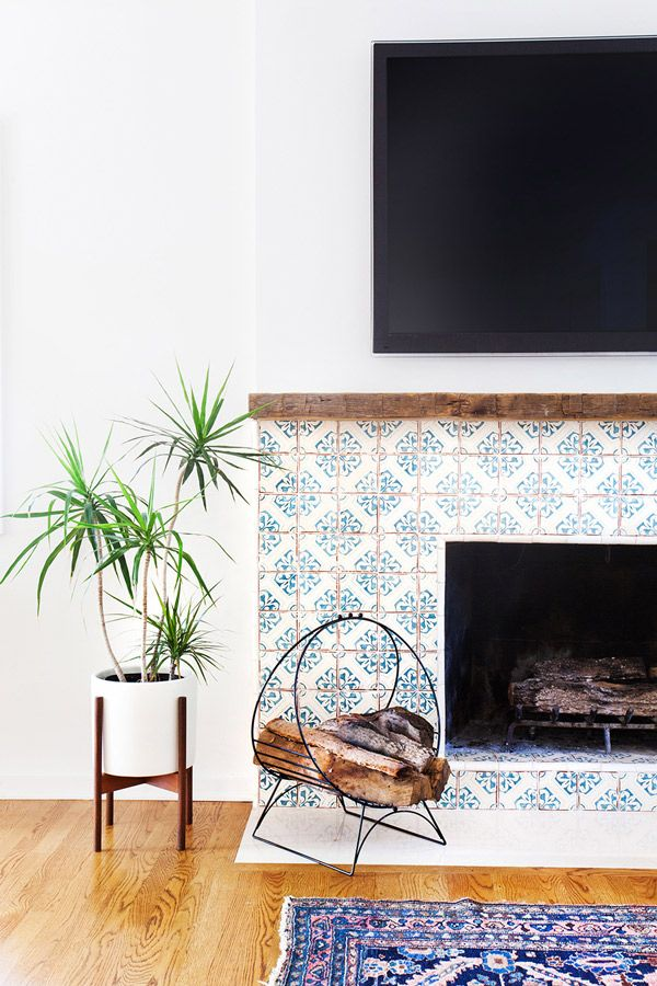 A light and airy tiled fireplace.