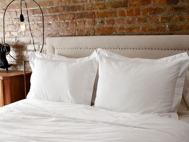 Canvas Headboard With Nail-Head Trim - DIY Furniture Projects: 5 Rustic Industrial Pieces on HGTV
