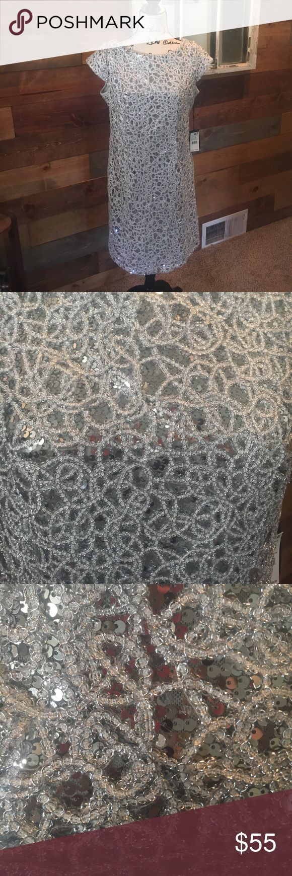 Adrianna Papell New silver sequin dress size 14 Adrianna Papell New silver sequin cocktail dress size 14. Very sparkly and comfortable. Fitted but not tight. Website refers to it as curve skimming. Brand new with tags but store doesn't accept returns and I found another dress. Has cap sleeves. Purchased dress for $69.99 and with S&H & taxes it came to $80. Adrianna Papell Dresses Midi