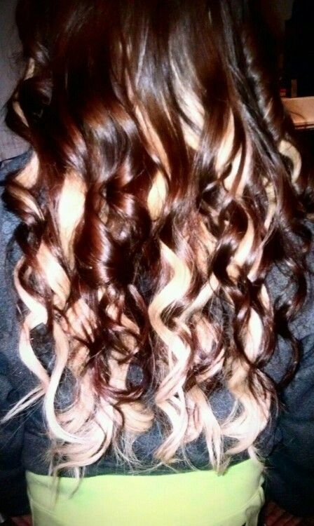 Chocolate brown hair with bleach blonde underneath.  Styled in curls