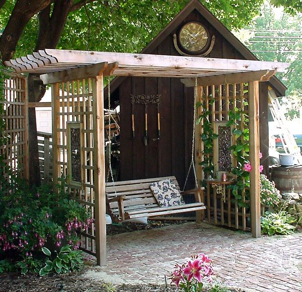 Arbor/swing (you can see the entire garden from here.) I would love this in our back garden. Seems like a nice private little place away from the house where two can sit and have a heart-to-heart. Two chairs would also do well if the swing wasn't an option.