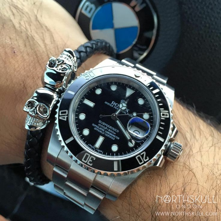 Fan Instagram Pic ! | While behind the wheel of his BMW @Mohmash is ready to go with his Black Dial Rolex Submariner Watch nicely paired with our premium Black Nappa Leather & Silver Twin Skull Bracelet. Great combo ! | Available now at Northskull.com | For a chance to get featured post a cool photo of your Northskull jewelry with the tag #Northskullfanpic on Instagram