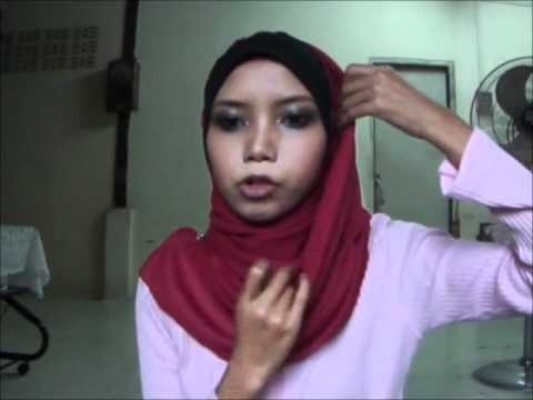 THIS YOUTUBE SITE OFFERS DIFFERENT STYLES....tudung bawal seperti shawl