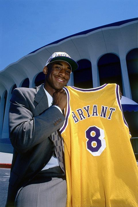 A young Kobe holding up his Lakers jersey  TipChallenger, test you skill and knowledge of sport and share in $5,000 Daily Jackpot.    Do you have what it take to beat the Challenger?