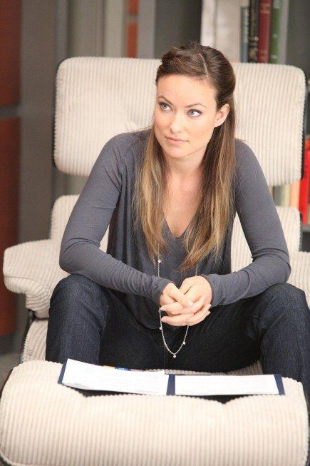 Olivia Wilde in House's Eames lounge chair. Both magnificent.