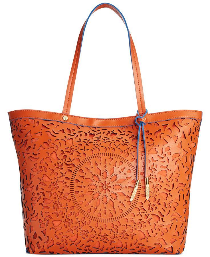 Intricate cutouts make this Carlos by Carlos Santana Kailee shopper bag a total work of art