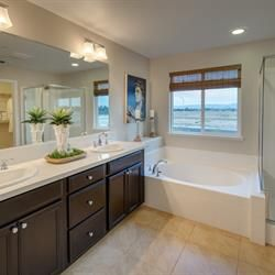 A master bath you'll truly relax in. Find elegant comfort throughout the homes here at Summerfield in Soledad, CA.   New homes by Benchmark Communities in the Monterey Bay Area.