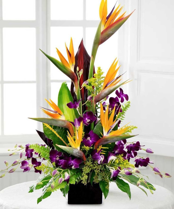 Birds in Paradise...Give someone this exotic arrangement of Birds of Paradise with vibrant purple dendrobium orchids and lush greenery. Beneva Flowers - Sarasota,FL