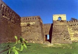 Sloped walls to defend agains a belfry (rolling tower with a drawbridge that drops down on the defender's wall). Derbent summer.jpg