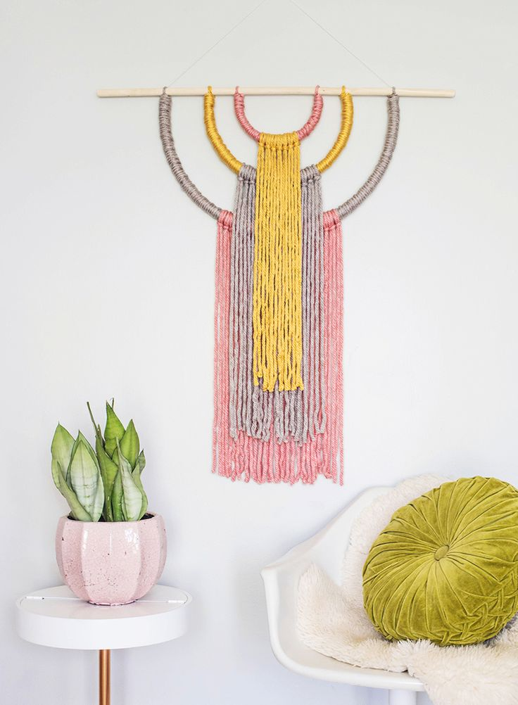 Statement Wall Hanging using a dowel, 3 embroidery hoops, hot glue and yarn. Easy peasy