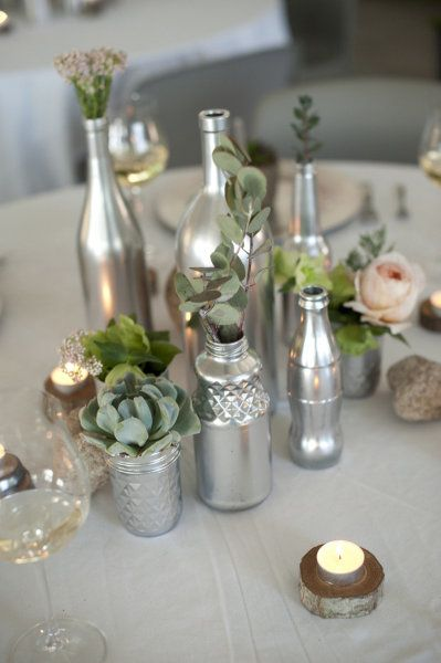 Such a great and inexpensive way to add color to your table - paint recycled glass bottles...