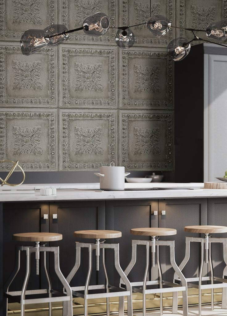 This industrial restored tin ceiling tile effect wallpaper features a weathered grey ornamental ceiling tile with silver metallic accents to give a subtle shine