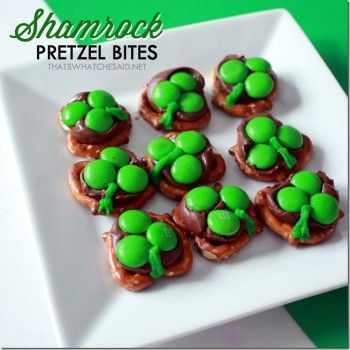 Shamrock Pretzel Bites.  On a parchment lined cookie sheet, bake pretzels with Hershey's kiss on top for 7 minutes at 200 degrees.  Remove and immediately press three green M & M candies.  When cool, use icing tip of green frosting to draw on the shamrock stems.