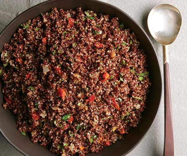 Tuscan Toasted Red Quinoa Pilaf. 2 cups red quinoa  4 cups lower-salt chicken or vegetable broth  2 Tbs. vegetable oil  1 large yellow onion, chopped (about 2 cups)  1 Tbs. minced garlic  1 medium lemon, finely grated to yield 1 tsp. zest and squeezed to yield 2 Tbs. juice  2 Tbs. extra-virgin olive oil  Kosher salt and freshly ground black pepper  1/2 cup chopped oil-packed sun-dried tomatoes  1/2 cup chopped fresh basil