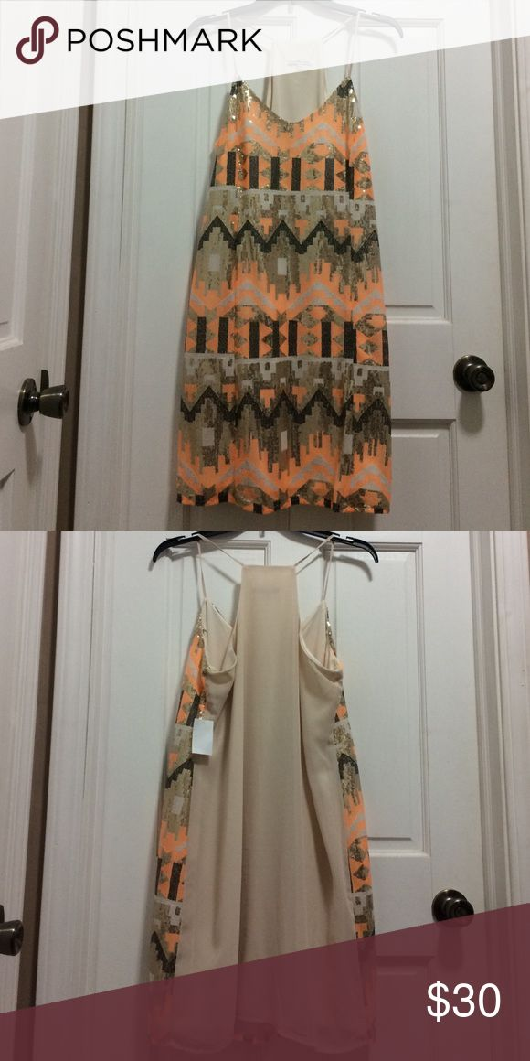Casual/special occasion dress Gold, orange and beige Aztec print dress w/ spaghetti straps. Never worn. Charlotte Russe Dresses Mini