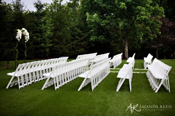 Arranged in flawless rows, lawn chairs await a large wedding party at the Resort at Glade Springs.  The Resort can host weddings with as few as twenty to as many as three hundred guests.