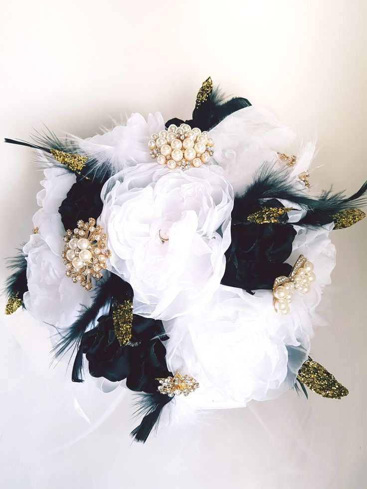 """Great Gatsby inspired Bridal Brooch Bouquet, Wedding Bouquet. Stunning Black White and Gold. White organza and black satin handmade flowers. Gold tone brooches with wispy white and sparkly gold tipped feather accents. 11"""" bouquet."""