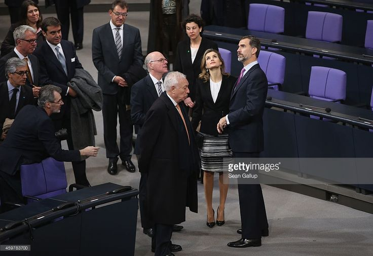 Bundestag President Norbert Lammert (C, behind) gives King Felipe VI (R) and Queen Letizia of Spain a tour of the Bundestag plenary hall on December 1, 2014 in Berlin, Germany. King Felipe and Queen Letizia are on their first state visit to Berlin since assuming the Spanish throne.