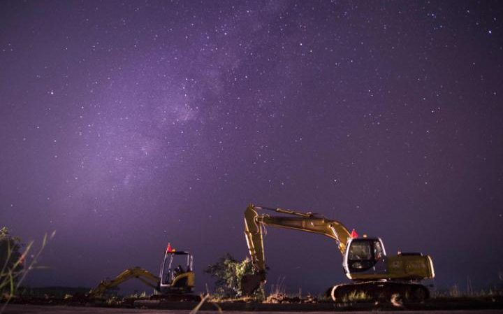 The Milky Way in the clear night sky over a construction site along the Yangon-Naypyidaw Highway,Burma