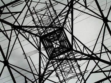 The silhouette of steel girders of a hydro tower create an abstract web of geometric shapes